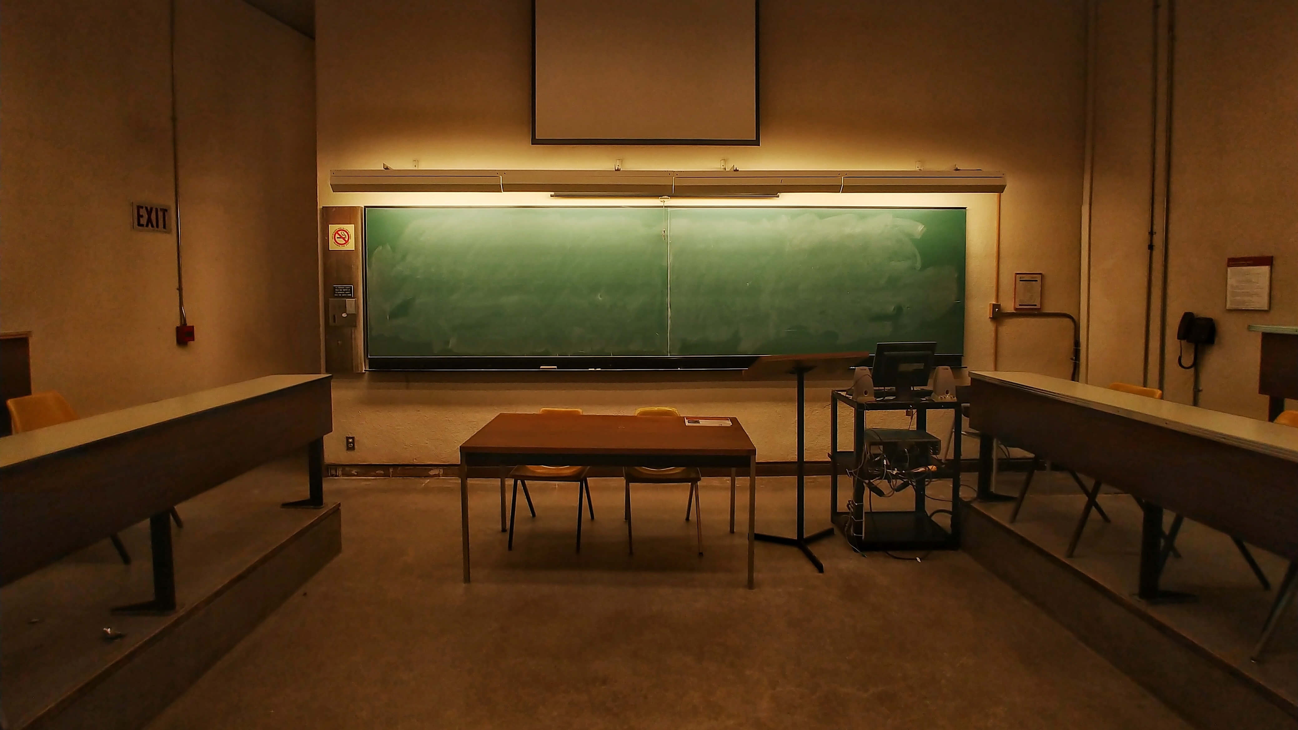 An empty classroom with a blackboard