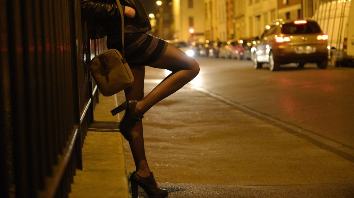 Woman prostitute standing in the street in Prague