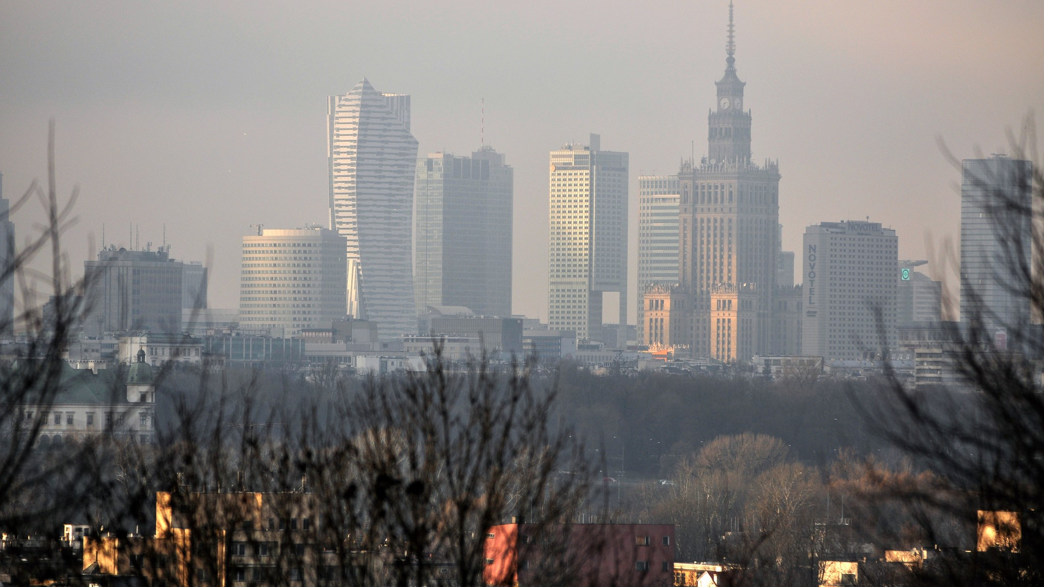 The Warsaw skyline under the smog