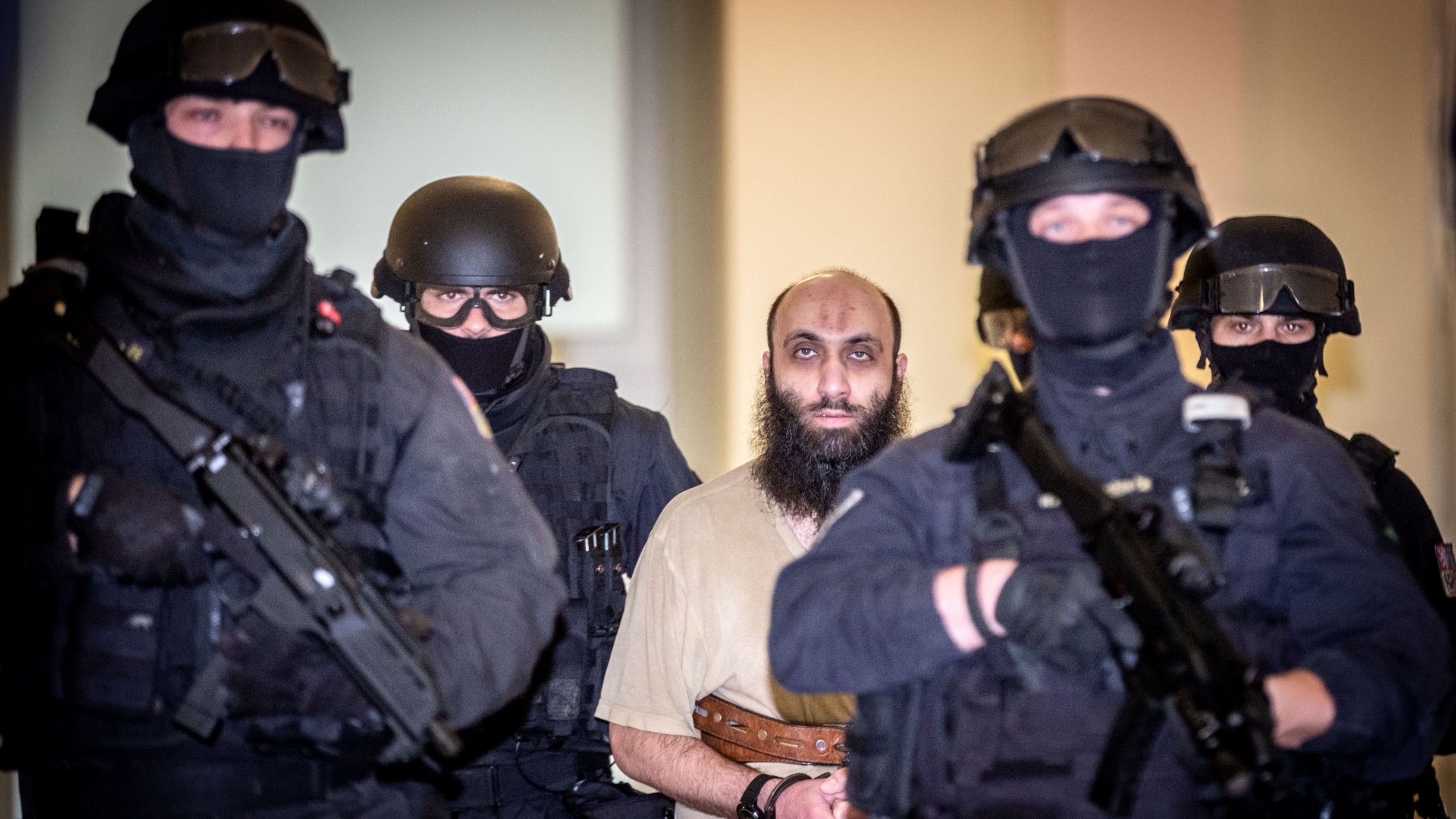 Former Prague Imam Samer Shehadeh escorted by police in a Prague court